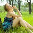 Pretty smile teen girl in blue dress on the meadow — Stock Photo