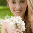 Royalty-Free Stock Photo: Portrait of pretty teen girl with white flowers in the park