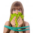 Beautiful young woman with lettuce and tape measure isolated — Stock Photo
