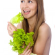 Picture of happy woman with lettuce over white — Stock Photo