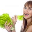 Portrait of happy woman with lettuce over white — Stock Photo