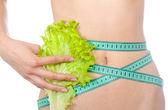 Cinta métrica y hoja de lechuga en la cintura aislada — Foto de Stock