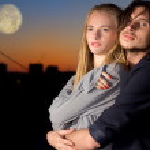 Attractive couple in twilight outdoor — Stock Photo