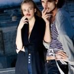 Stylish couple smoking outdoor on the night — Stock Photo #3547840