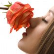 Beautiful woman with rose sideview isolated — Stock Photo #3752012