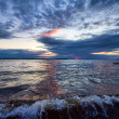 Dramatic sundown seascape - Stock Photo