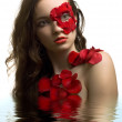 Sensuality young woman in rose petals water mirror — Stock Photo #3752077