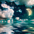 Wonderful moonlight in ocean at night - Stock Photo