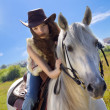 Young cowgirl gallop on white horse — Stock Photo #3752101