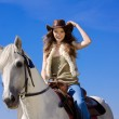 Young cowgirl on white horse smile — Stok fotoğraf #3752104