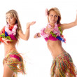 Two pretty dancers in hawaiian costumes isolated — Stock Photo