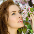 Beautiful woman in blossom orchard — Stock Photo