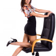 Stock Photo: Beautiful sexy brunette on armchair isolated