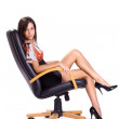 Sexy brunette in mini seat on armchair — Stock Photo