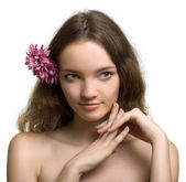 Beauty woman closeup portrait with flower isolated on white back — Stock Photo