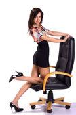 Beautiful sexy brunette on armchair isolated — Stock Photo
