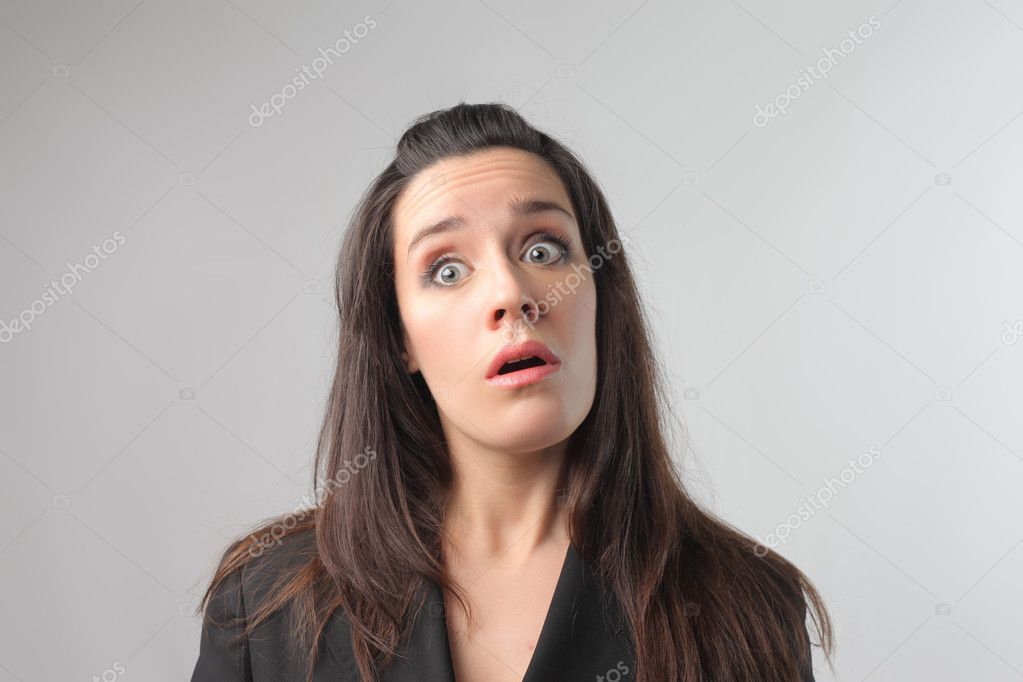 Young woman with astonished expression  Stock Photo #3121792