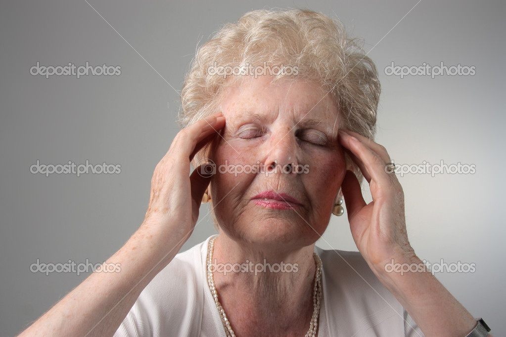 Senior woman with headache — Stock Photo #3121796