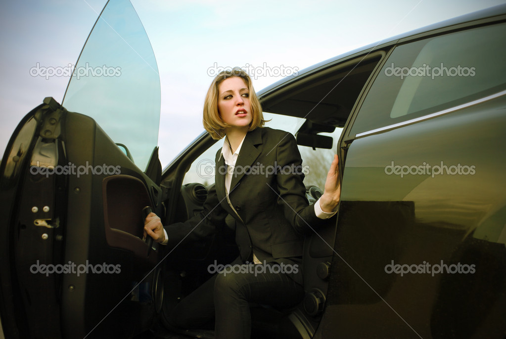 Businesswoman coming out of a car — Stock Photo #3194094