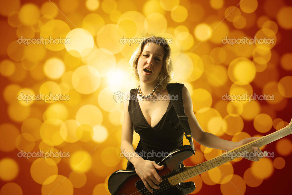 Young woman playing the bass guitar — Stock Photo #3194118
