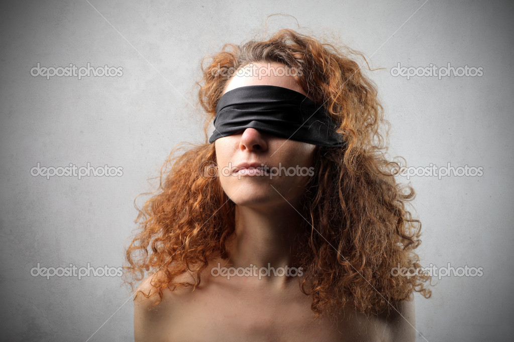 Blindfolded red haired woman — Stock Photo #3194905