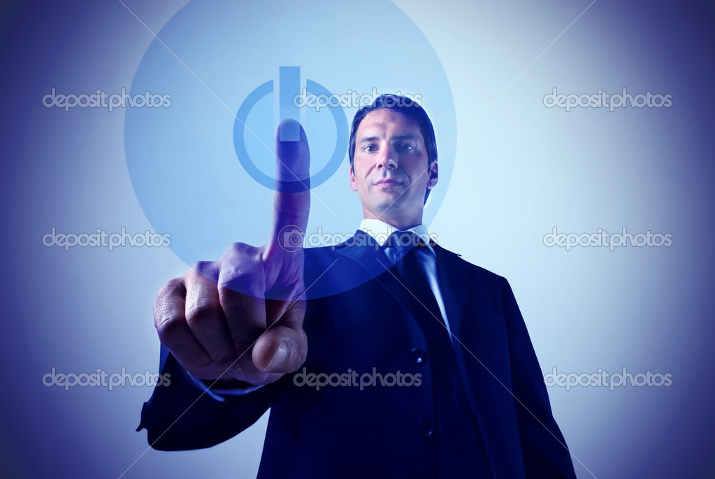 Businessman pressing the start button on a touchpad — Stock Photo #3195055