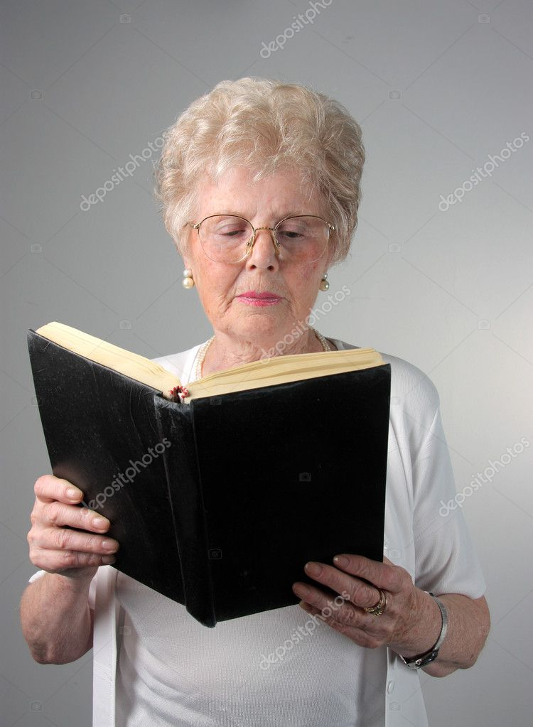 Senior woman reading a book — Stock Photo #3195377