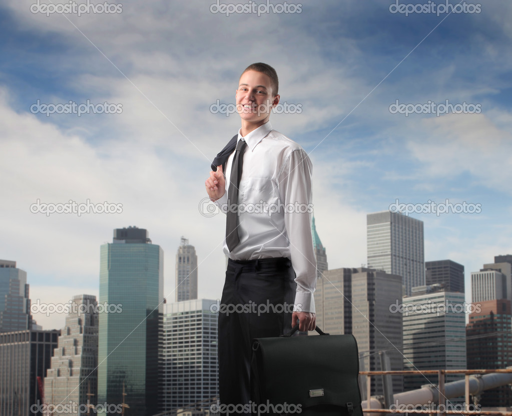 Young businessman with cityscape on the background — Stock Photo #3195458
