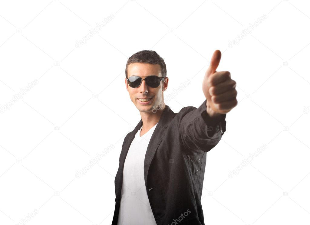 Handome man with sunglasses and thumbs up — Stock Photo #3196405