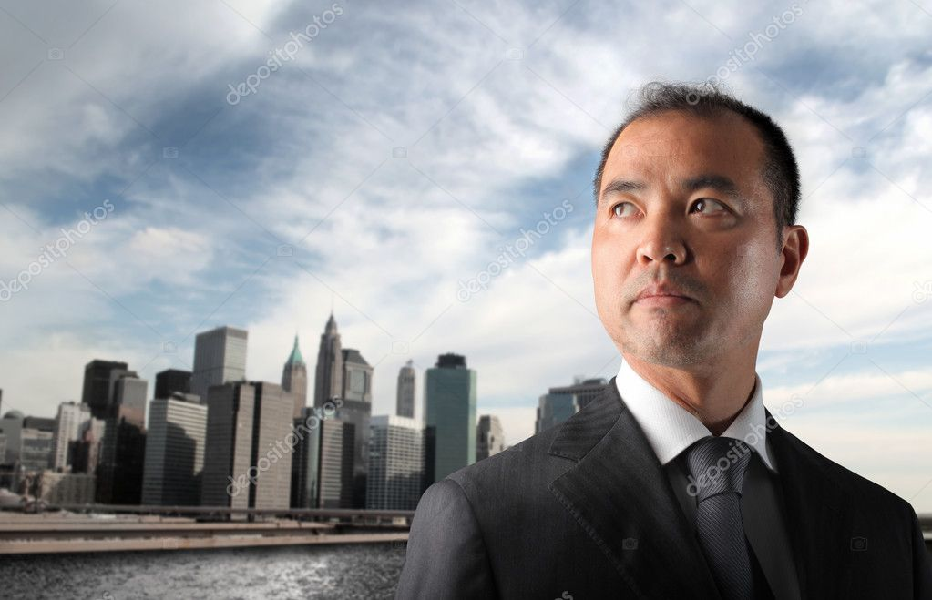 Japanese businessman with cityscape on the background — Stock Photo #3196899
