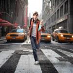 Student running on a city street — Stock Photo #3208184