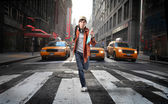 Student running on a city street — Stock Photo