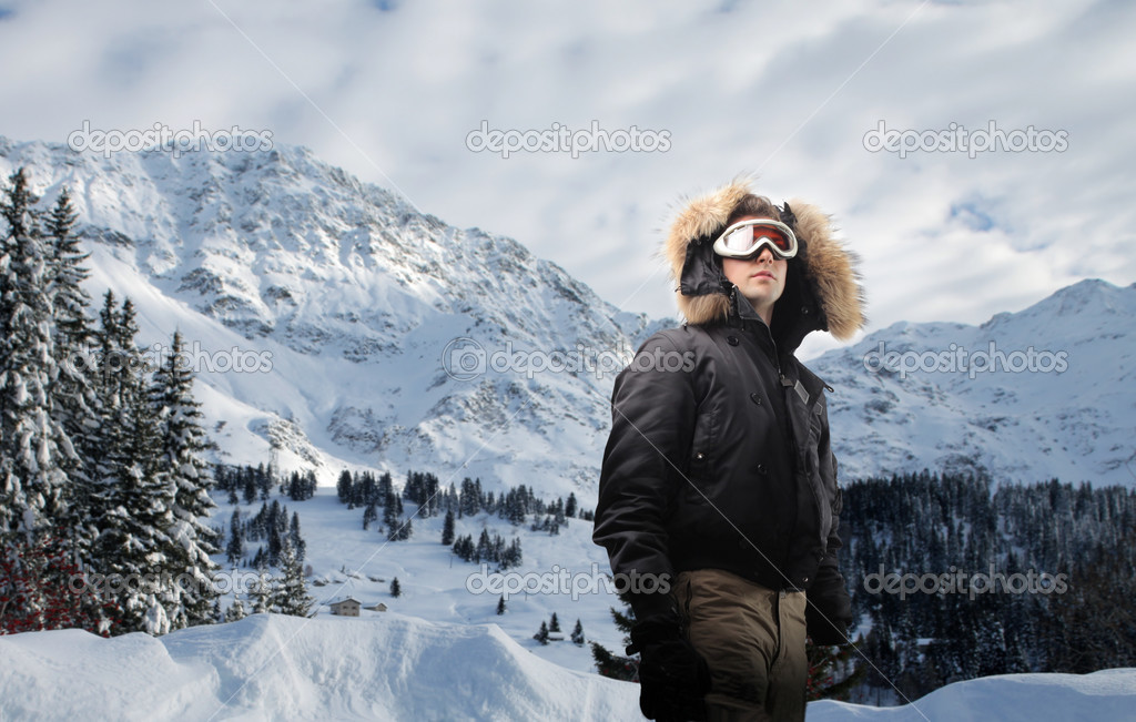 Young man with mountains on the background — Stock Photo #3201111