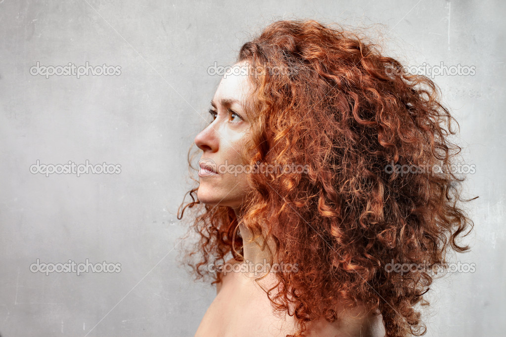 Profile of a woman with red hair — Stock Photo #3202465