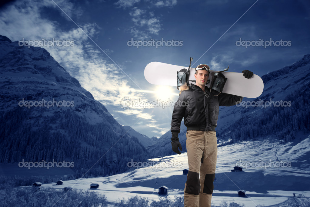Young man with snowboard at the mountain — Stok fotoğraf #3208115
