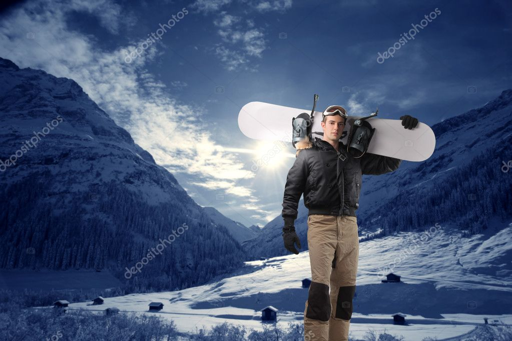 Young man with snowboard at the mountain — Zdjęcie stockowe #3208115