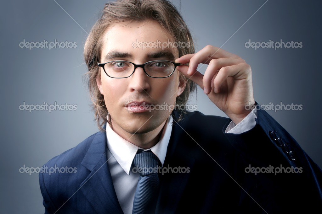 Handsome businessman in attention gesture  Stock Photo #3231798