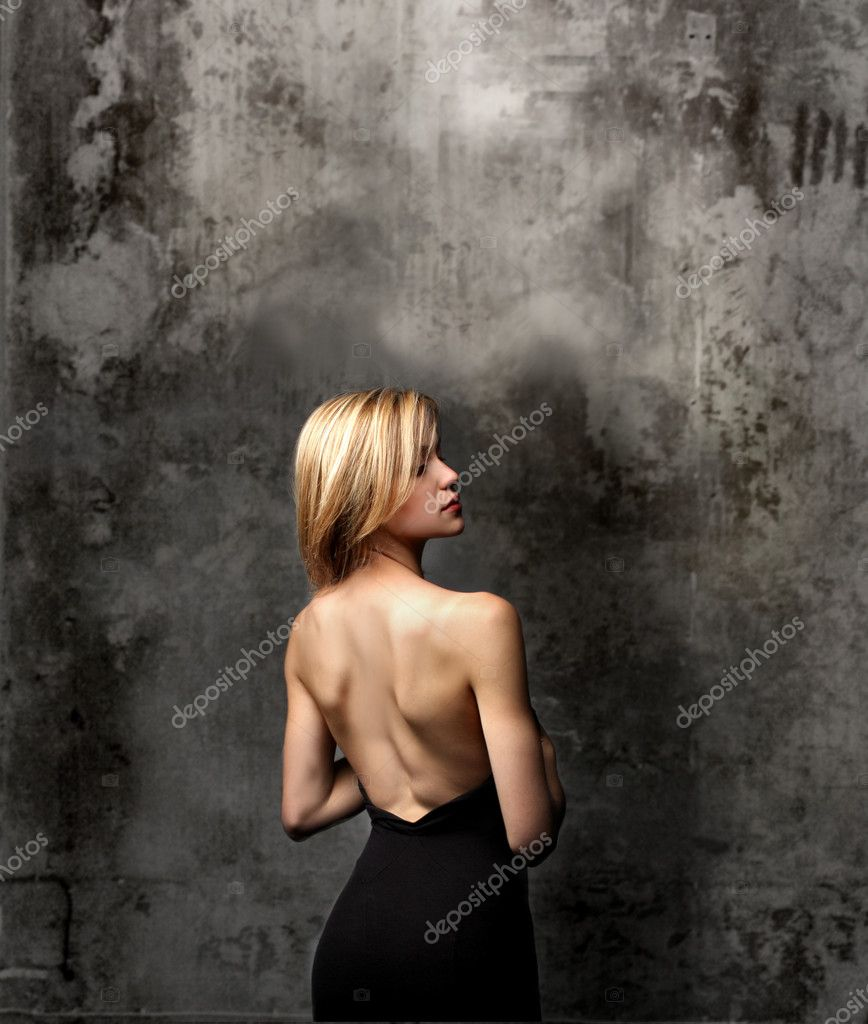 Rear view of beautiful blond woman on cracked background — Stock Photo #3231819