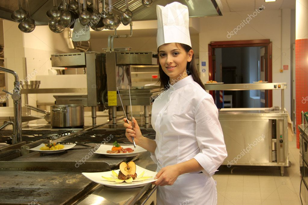 Female cook in the kitchen of a restaurant   Foto Stock #3233253