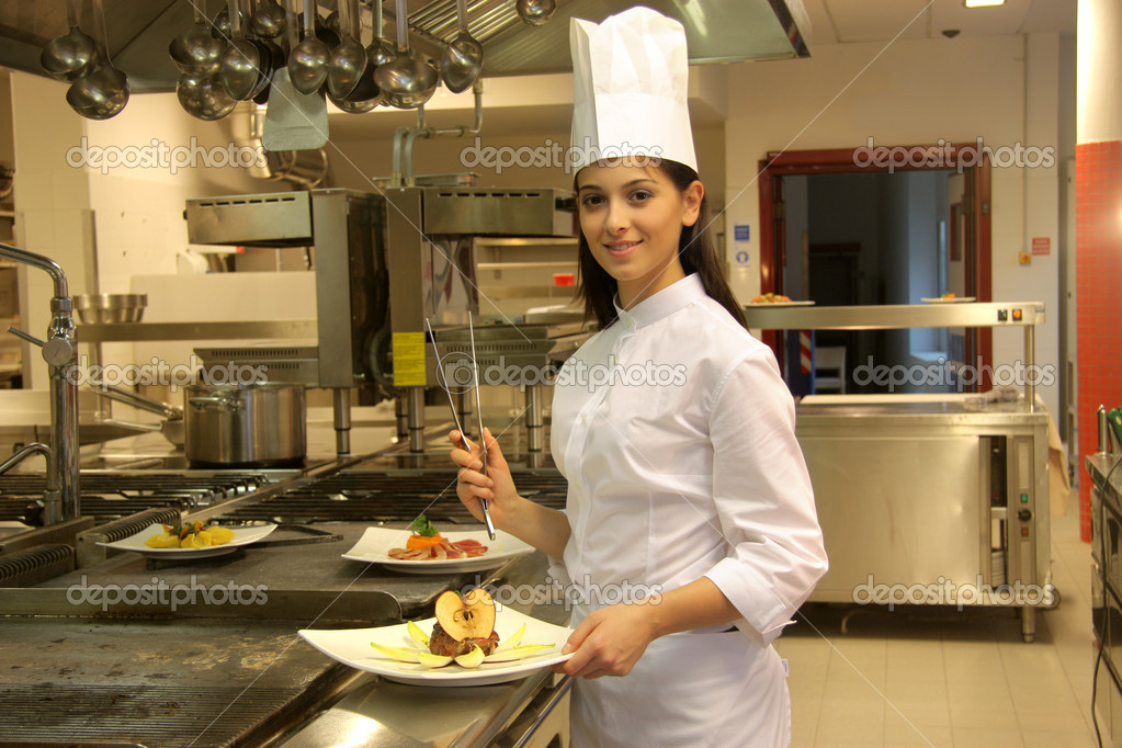 Female cook in the kitchen of a restaurant   Stock Photo #3233253