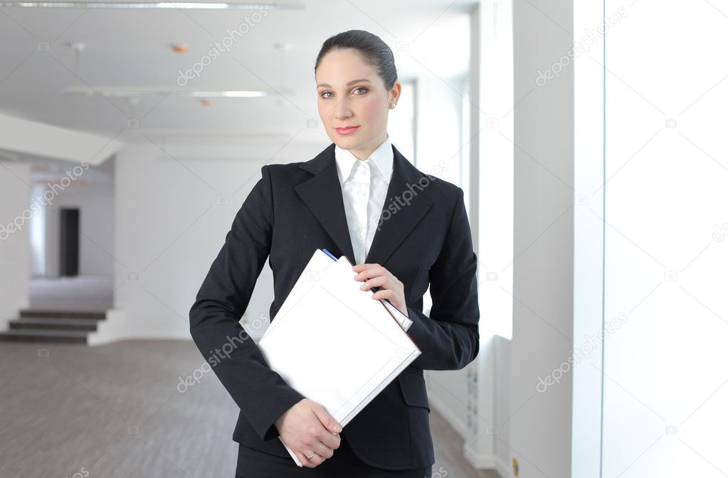 Businesswoman at the office  Stock Photo #3382179