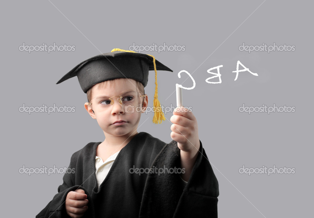 Child in graduate uniform writing alphabet letters — Stock Photo #3388972