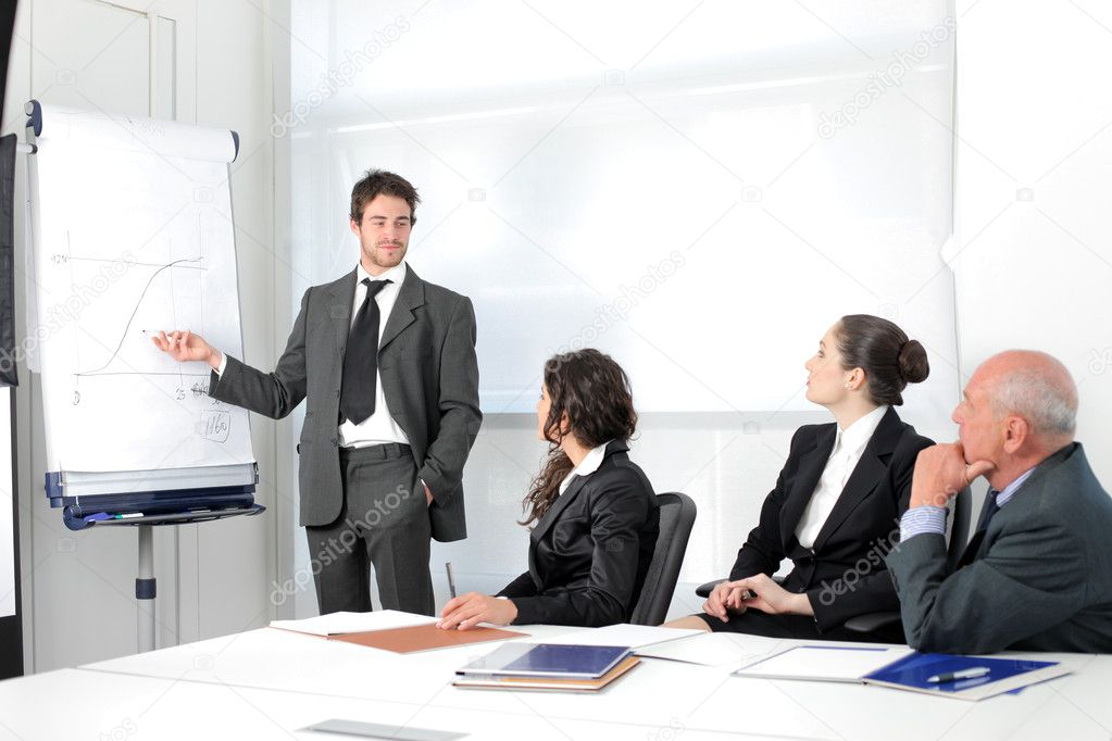 Young businessman presenting some prospects during a meeting — Stock Photo #3389521