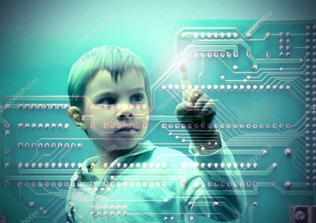 Child touching a microchip  Stock Photo #3397515