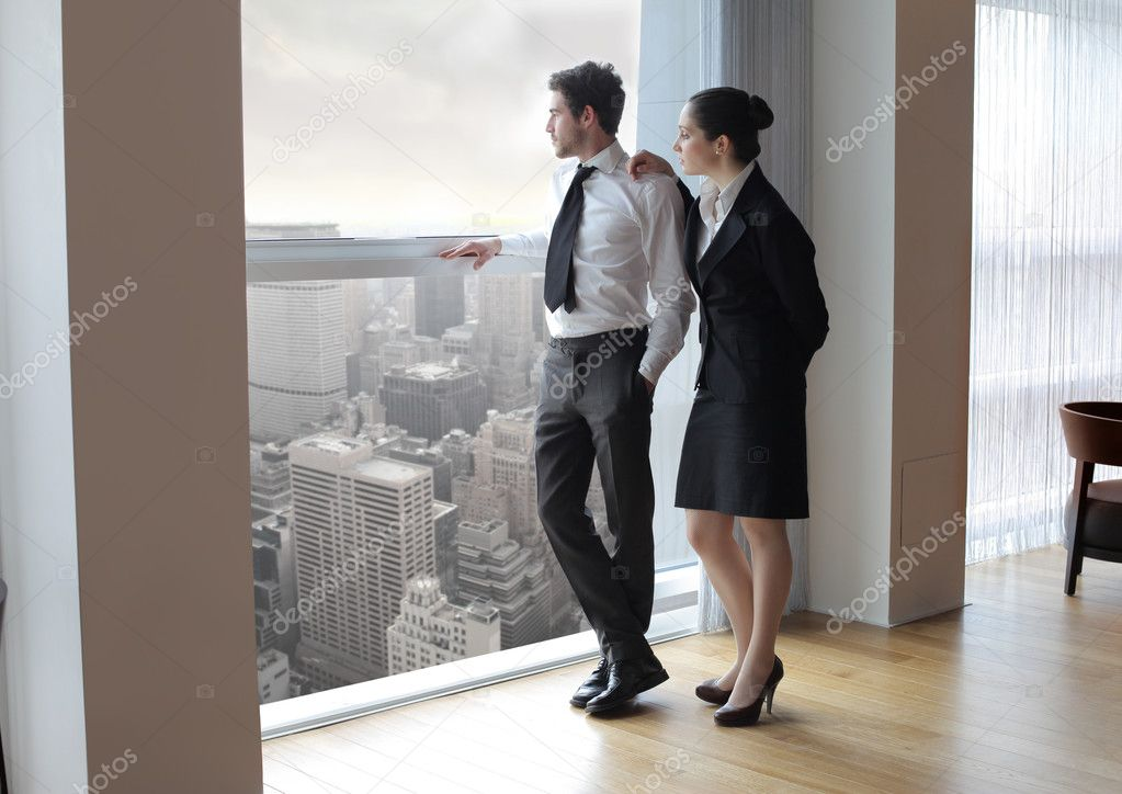 Business looking out of the window of an office — Стоковая фотография #3397667