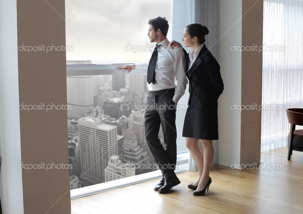 Business looking out of the window of an office  Foto de Stock   #3397667