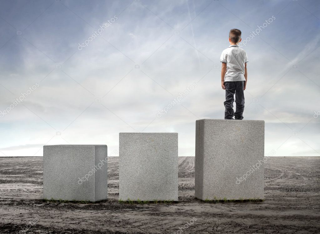 Child standing on the highest of three cubes — Stock Photo #3854772