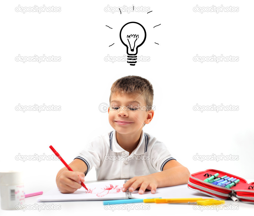 Child having an idea while drawing  Stock Photo #3854854
