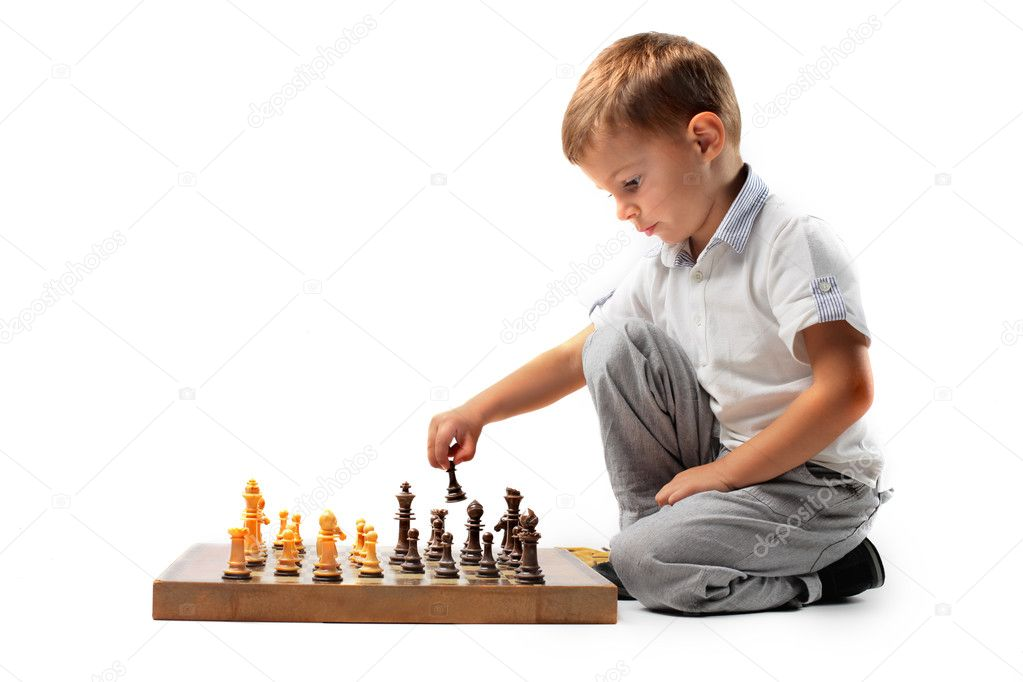 Child moving a chessman on a chessboard — Stock Photo #3857910