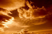 Dark storm clouds with red sky — Stock Photo